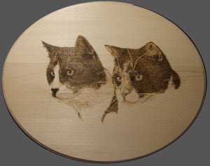 pyrography drawing of cats