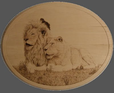 two lions pyrography in progress