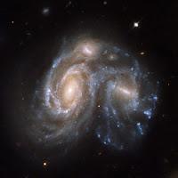 Galaksit NGC 6050 ja IC 1179 ottavat mittaa toisistaan