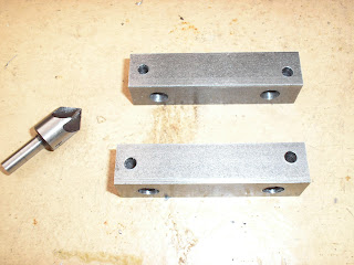 Arms drilled and deburred