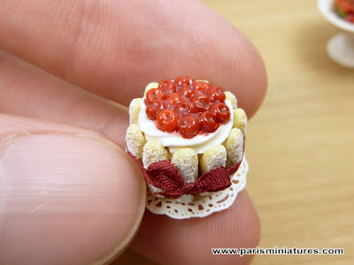 Miniature Cherry Charlotte held in hand