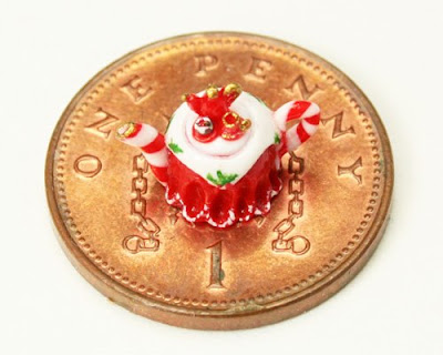 quarter scale miniature handmade Christmas teapot shown on a British penny