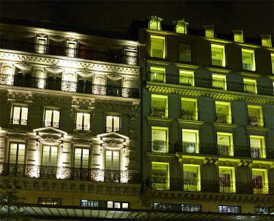Illuminated Parisian apartment windows at night