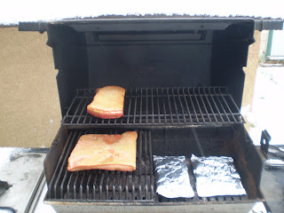 My barbeque set-up for smoking: wood chip packets on one side with heat on, meat on the other side with heat off