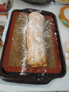 The strudel, after baking, dusted with icing sugar