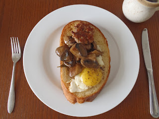 Our quenelle test: a small sausage patty and a fried egg both resting on an enormous piece of toast