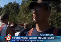 This is a picture of a firefighter who stood by and watched a citizen's home burn to the ground