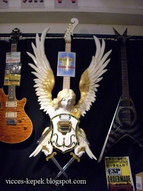 [small_awesome%20angel%20guitar.jpg]
