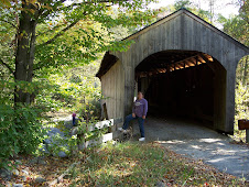 Jeri in front of a covered bridge in VT