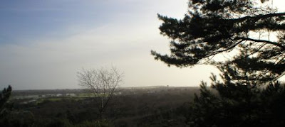 view of Christchurch Priory from St Catherine's Hill