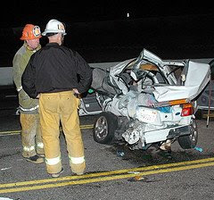 Compact Sedan and Ambulance collide. © Photo by Mike Meadows. Click to see more...