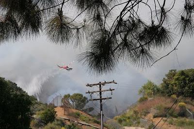 LAFD Helicopter battles wildfire on April 26, 2008. &copy; Photo by Frazgo