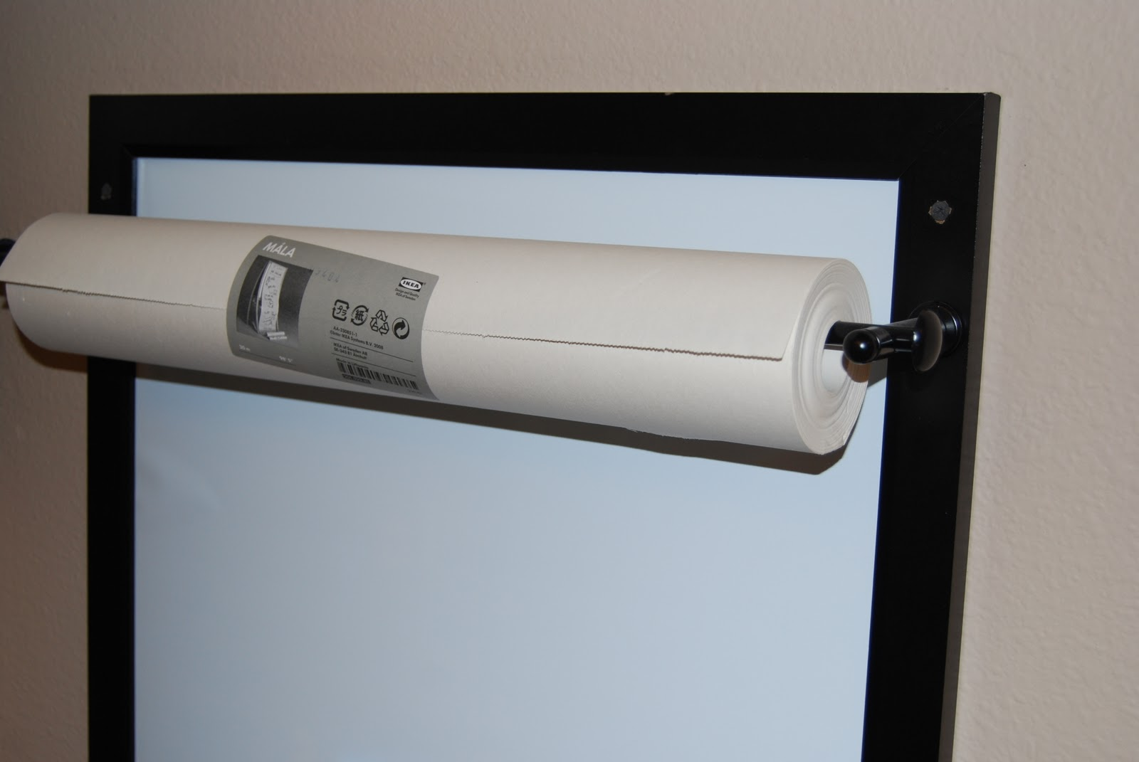 ... to the wall, with screws - add paper roll to curtain rod and enjoy