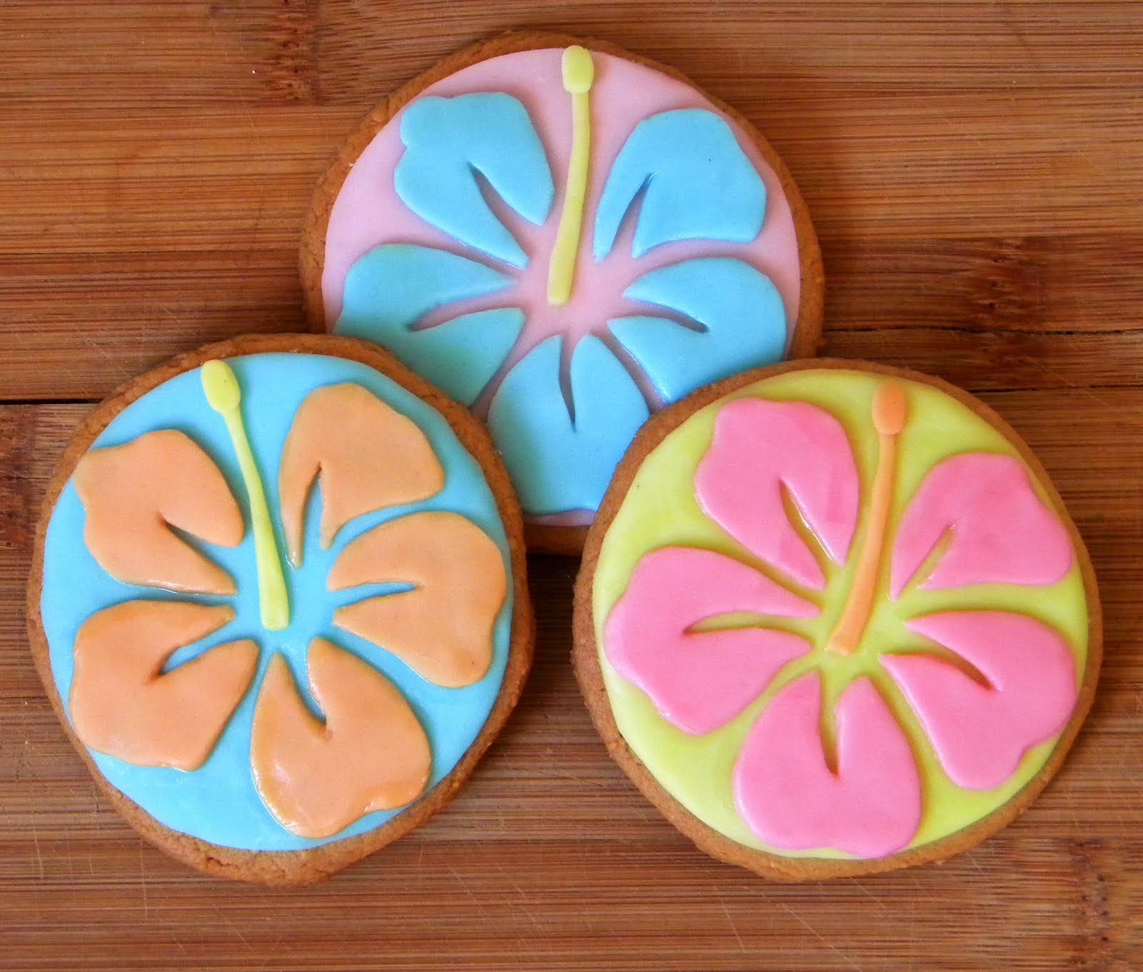 Jocelyns delicious delights hibiscus sugar cookies hibiscus made of fondant petals on a sugar cookie base can be made with custom colours or as a colourful variety izmirmasajfo