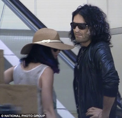 Russell Brand arrested at airport after 'attacking photographer'
