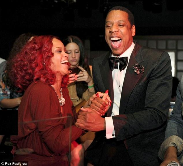 beyonce red hair rihanna. Having a ball: Rihanna looked