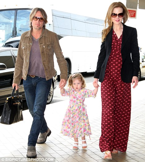 Heading home to meet Faith: Kidman, Urban and their daughter Sunday flew