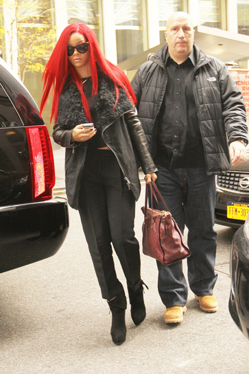 rihanna red hair up. Rihanna#39;s bright red hair,