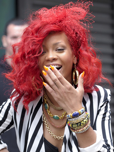 rihanna pics with red hair. rihanna red hair long 2010.