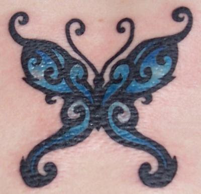 black butterfly tattoos. tribal utterfly tattoo