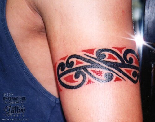 you'll see that the tribal arm tattoo is popping up everywhere.