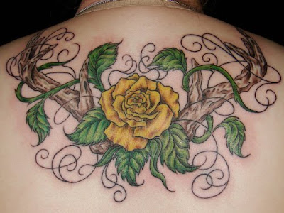 Yellow Rose and Branch Hands tattoo