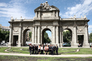 The Alcala gate in madrid with all the team