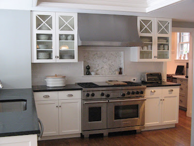 I think the gray walls of the kitchen with a touch of marble and beadboard