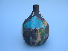 Raku Bottle  10 inches high