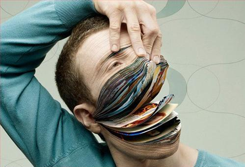 Man With Magazine Pages Instead of His Face