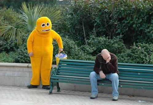 Yellow Mascot Man Here to Cheer Up Bench Man