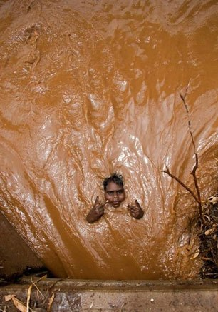 Indian Trapped in Brown Stuff - WTF Pics