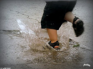 Child running through a puddle