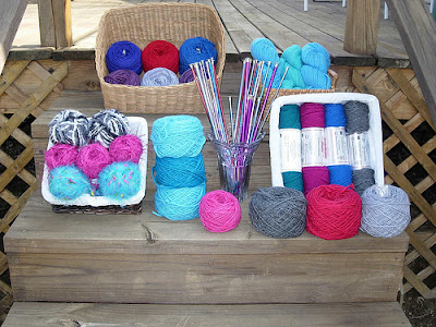 lots of knitting supplies - mostly yarn, some needles