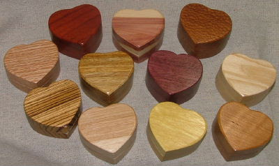 11 heart-shaped boxes in different woods