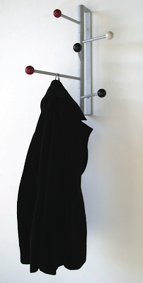 wall coat rack with jacket hanging on it