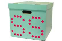 MeBox - cardboard storage box with dots to punch out to form letters, numbers, etc.