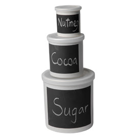 3 storage jars, different sizes; labeled in chalk as nutmeg, cocoa, and sugar