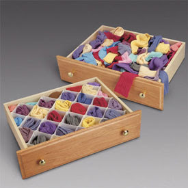 many colored socks in drawers - one just tossed in, one using drawer dividers