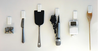 Endo magnet clips holding an iPod, a wooden spoon, a spatula, a knife, etc.