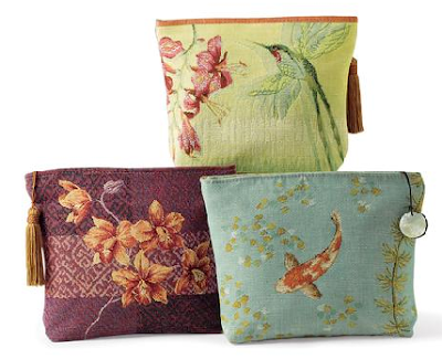 accessory bags with orchids, koi, and hummingbird designs