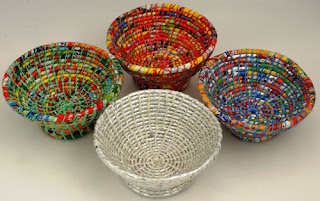 four bowls made from recycled plastic food wrapping