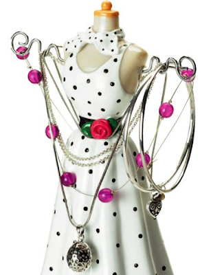 jewelry mannequin shown with jewelry hung from it