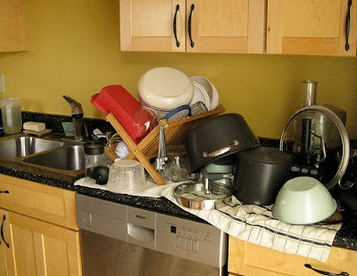 Dishes Drying In A Rack And On Towels Placed On The Countertop