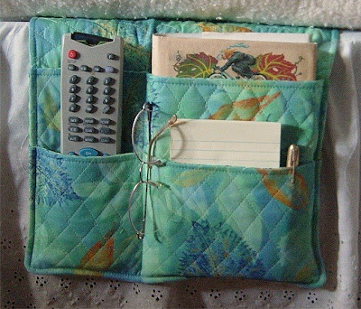 bed caddy with remote, notepad and pen, eyeglasses, and more