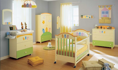 room full of colorful children's furniture - crib, dresser, armoire, changing table