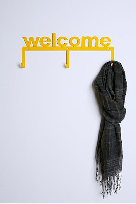 hook, bright yellow, says welcome, scarf hanging from it