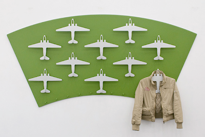 airplane-shaped hangers, on the wall