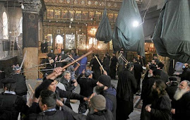         (Monks are trading blows at Church of Holy Sepulchre)