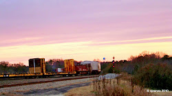Pastels wash the Hamlet Eastern sky and the railcars on November 25, 2008